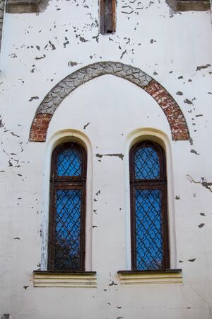 A window with a metal grille in an old house Stockfoto - 133463189