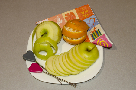 the cut fruit on a plate apple orange cutting by segments