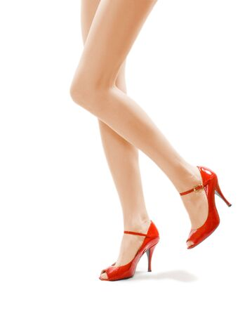 female legs in red shoes Stock Photo
