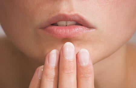 finger on lips: female lips and fingers