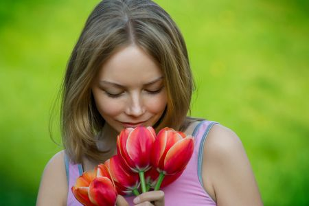 beautiful young lady with flowers outdoor smiling photo