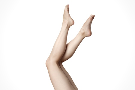 Close up of elegant female legs walking  photo