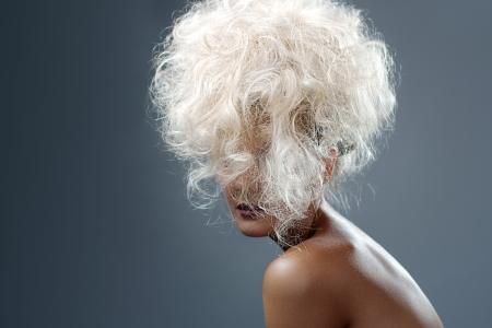 Beautiful Blonde Girl. Healthy Long Curly Hair photo