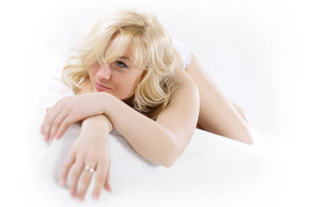 Sexy fit naked woman with healthy clean skin lying down photo