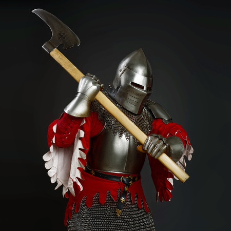 hauberk: Medieval knight in the field with an axe Stock Photo