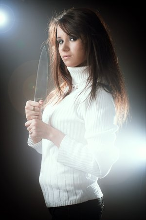 pull out: portrait of beauty woman pull out her Knife. ready to attack Stock Photo