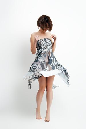 rhythm rhythmic: Young brunette lady in gorgeous dress. Fashion photo