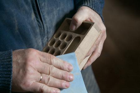 sandpaper: Man polishing sandpaper tree in one studio Stock Photo