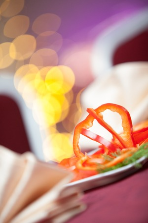 piri: red pepper salad on a plate in a restaurant Stock Photo