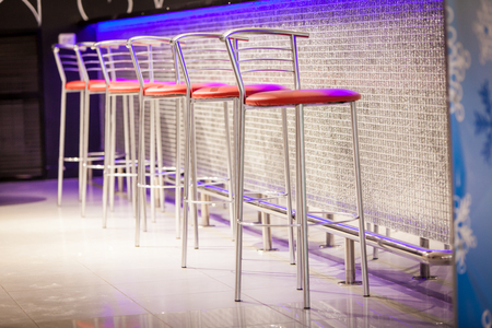 stools: The red bar stools in the restaurant Stock Photo