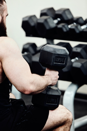 Bodybuilder working out in the gym weights