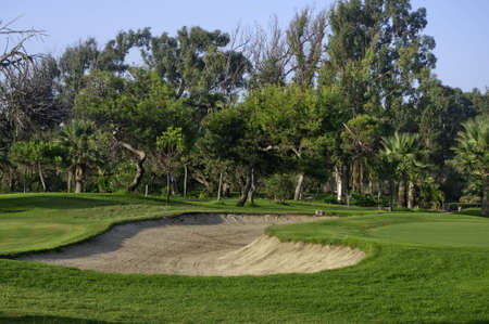 Golf course with bunker. photo