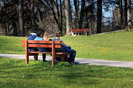 Enjoying sun in a park on the park bench