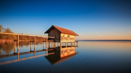 Boathouse in Stegen at the Ammersee at sunset in Bavaria Germany