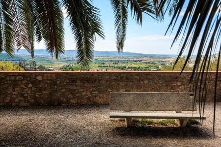 Rest on a hill in the old town of Suvereto overlooking the Tuscan countryside, Italy