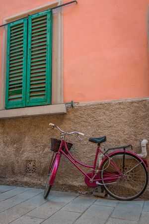 Bicycle in the backyard of the old town in Piombino, Tuscany, Italy Stock Photo