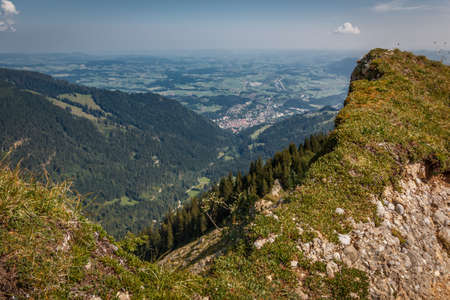 View from the top of the Steineberg to Immenstadt on the Nagelfluhkette chain in the Allgäu Alps