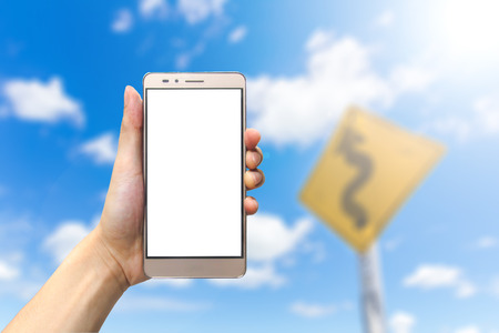 hand holding smartphone with blank screen on bluesky background