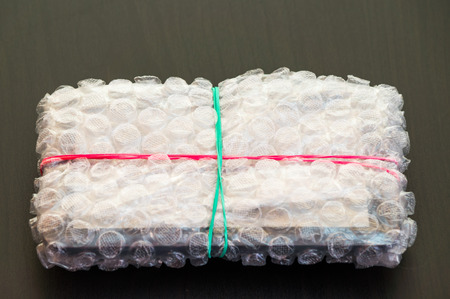 sealed: Packed and sealed electronic device in plastic wrap