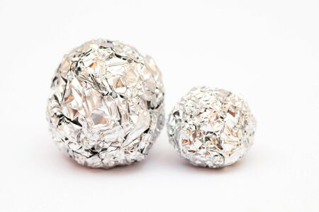 tine: Balls made of tine foil next to each other Stock Photo