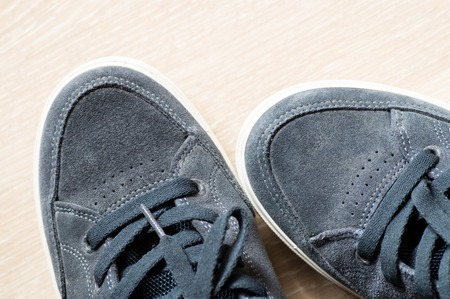 trouser legs: Skateboarding sneakers next to each other