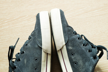 trouser legs: Skateboarding sneakers next to each other on their sides Stock Photo
