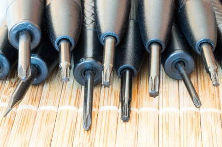 upper: Upper view of torx, flat and Philips precious screwdrivers