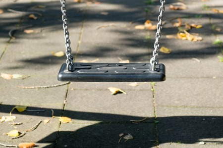 Plastic swing in a playground