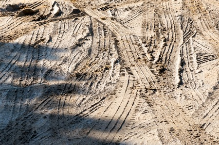 Many tire marks in the mud Stock Photo