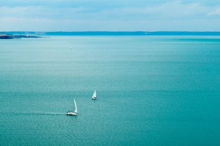 Few sailboats on water