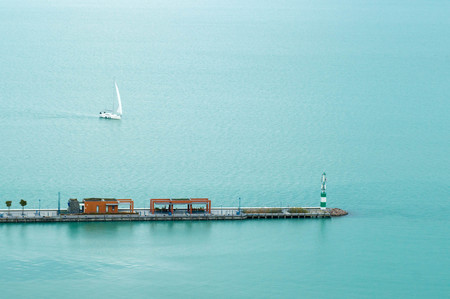Landscape photo of a pier and sailboats