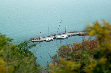 Docked sailboats on a short pier Stock Photo