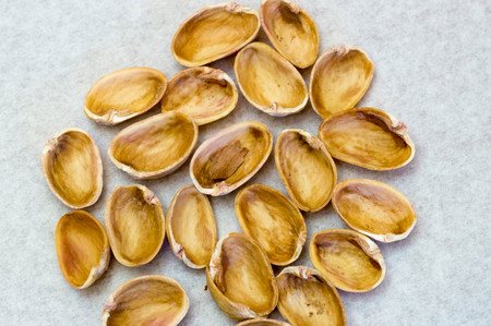 Many pistachio shells next to each other Stock Photo