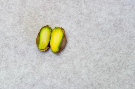 Pistachio nut inside in half Stock Photo
