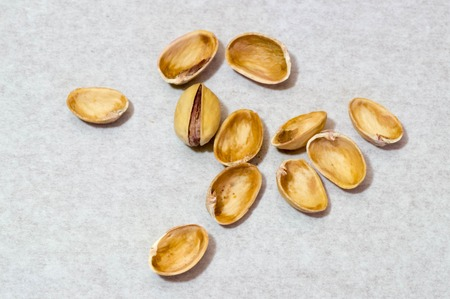 Pistachio nuts and shells in upper view