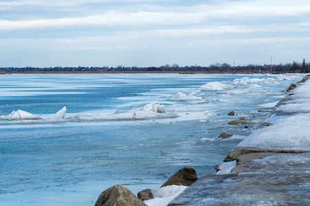 Iced shore with sidewalk Stock Photo