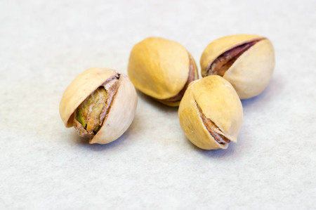 Few pistachio nuts next to each other