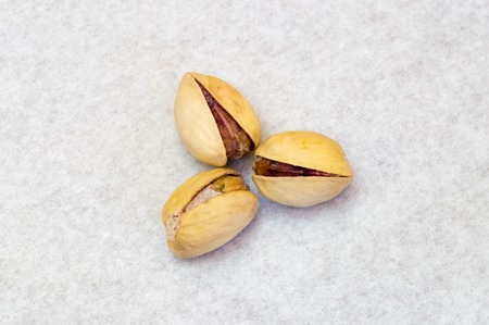 Three pistachio nuts in triangle form Stock Photo