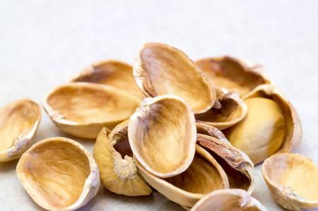 Empty pistachio nut shells on each other