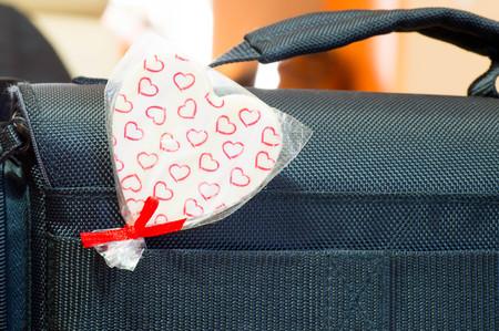 Heart shaped lollipop inserted in bags belt