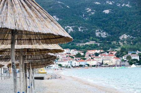 Beach with unused parasols