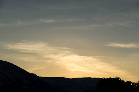 Sunset with hill and cloud