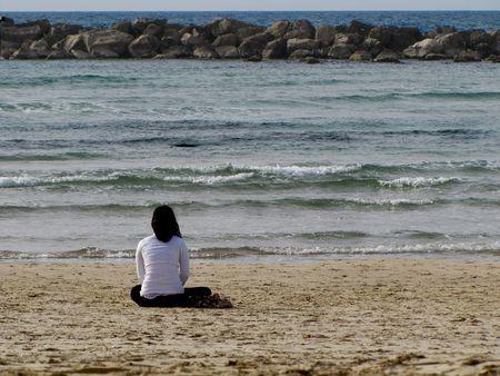 glaring: A woman glaring the horizon on the beach