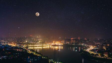 Dhaka bangaldesh hatirjheel landmark of dhaka night cityscpae with full moon adn star