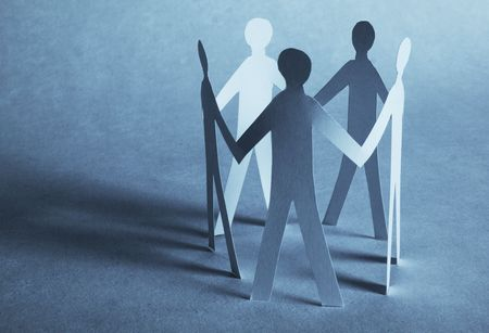 paper people holding for hands Stock Photo - 6057118