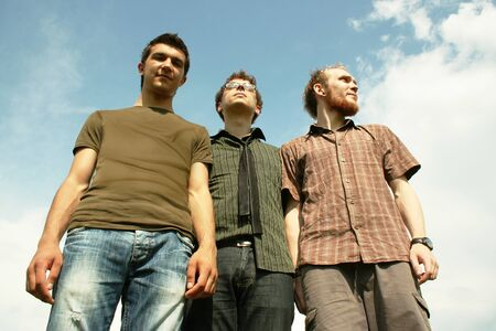 three young men standing outdoor Stock Photo - 7106472