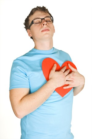 bosom: man in blue shirt pressing to bosom red decor paper heart isolated on white