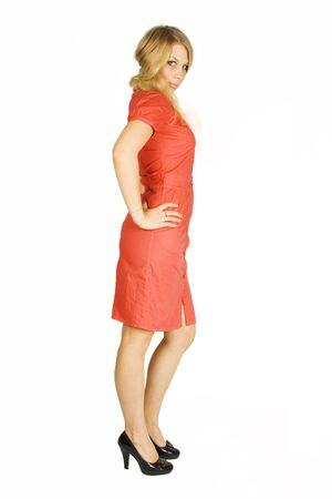 black heels: beauty blond girl in red dress and black heels looking at camera, side view isolated on white