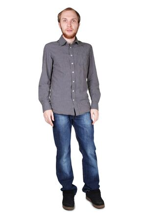 young man with beard in grey shirt and jeans standing isolated on white photo