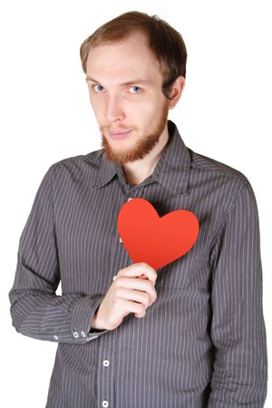 young man with beard in grey shirt holding red paper heart on his breast, half body, isolated photo